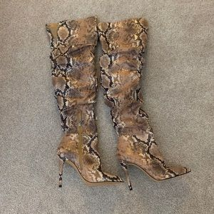 Thigh high snake skin boots